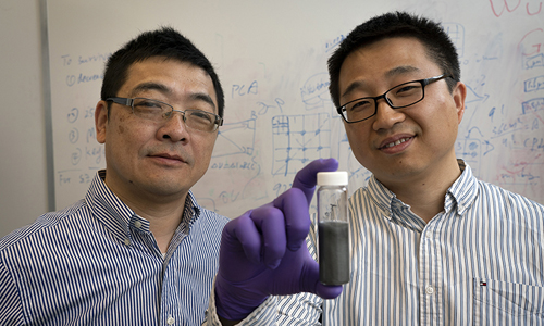 Purdue researchers Wenzhuo Wu and Peide Ye holding tellerene solution